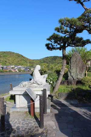 Tale of Genji Statue with the blue sky in Uji, Japan