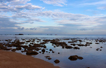 View of dawn at the seaside with the dramatic cloudscape and boats, Tioman Island