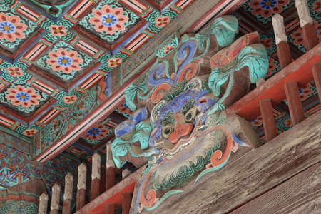 Korean traditional architecture detail of eaves with bestial face decoration at Bulguksa Temple in Gyeongju, South Korea Stock Photo