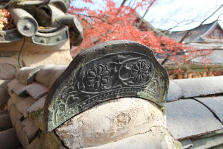 Close-up of traditional Korean ceramic roof tile with flower image on Bulguksa Temple, Gyeong-ju, South Korea