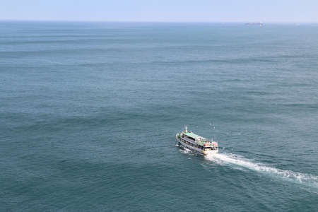 View of a ferry on the sea at Taejongdae recreational park, Busan, South Korea