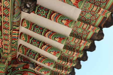 Korean traditional architecture detail of roof with colourful pattern at Beomeosa Temple in Busan, South Korea
