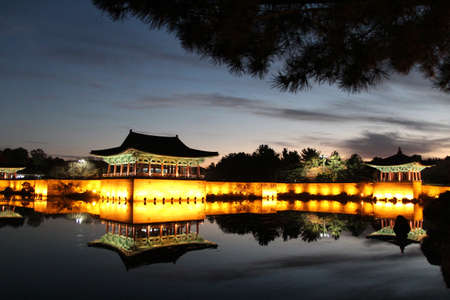 Night view of Donggung Palace and Wolji Pond with the light and reflection in Gyeongju, South KoreaNight view of Donggung Palace and Wolji Pond with the light and reflection in Gyeongju, South Korea