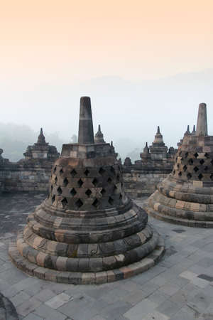 Borobudur Temple with the mysteries forest surrounding at dawn, Yogyakarta, Indonesia