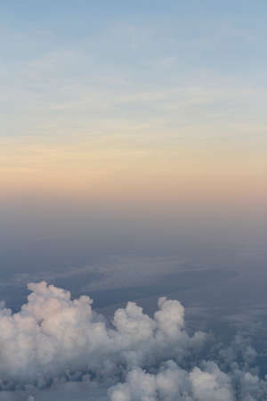 Dramatic cloudscape during sunrise from the airplane's window
