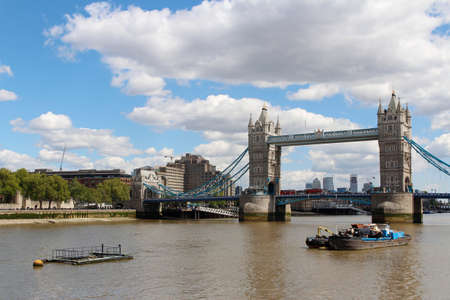 Tower Bridge with the blue sky and clouds on a bright sunny day in spring, London, UK