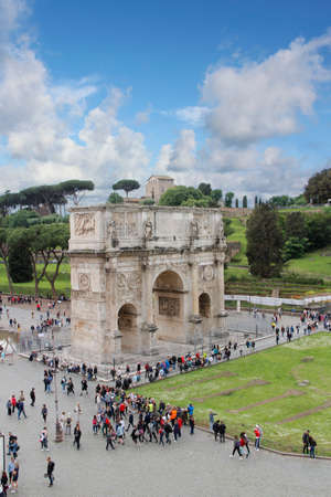 Arch of Constantine with the blue sky and clouds near the Colosseum in Rome, Italy