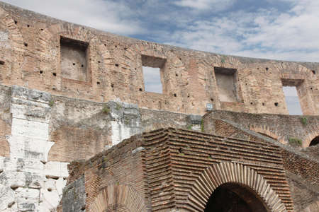 Interior of the Colosseum or Coliseum with the bricks wall and arches in Rome, Italy