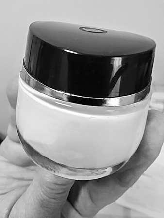 recipient: black & white  picture  of a cosmetic cream recipient
