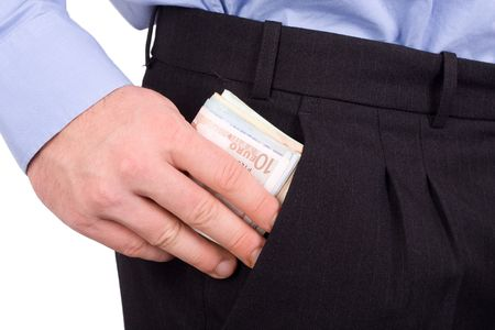 grasping: Businessman Putting Money Into Pocket Stock Photo