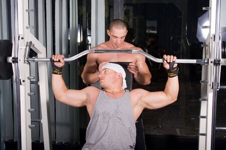 Two Bodybuilders training in the gym photo