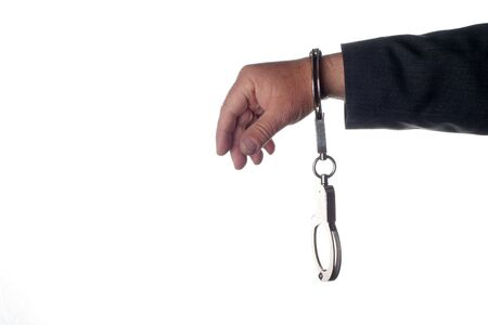 Hand wearing handcuffs with isolated  Stock Photo - 3619423