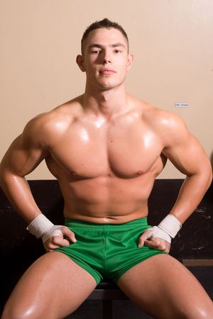 bodybuilder posing in gym photo