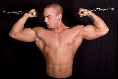 bodybuilder training: Bodybuilder training in the gym Stock Photo