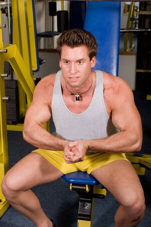 young bodybuilder posing in the gym Stock Photo - 4327840