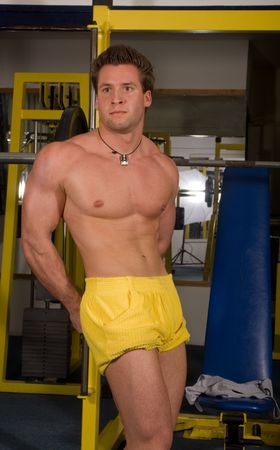 young bodybuilder posing in the gym Stock Photo - 4327815