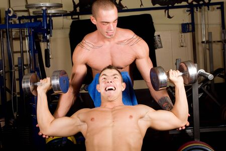 Two Bodybuilders training in the gym together photo