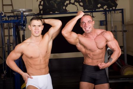 Bodybuilders posing in the gym photo
