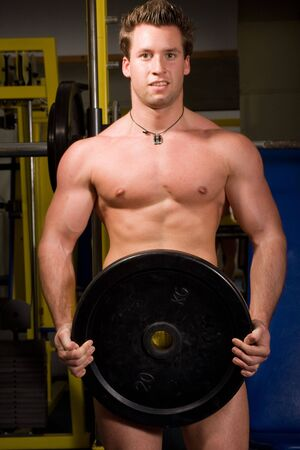 young Bodybuilder training Stock Photo