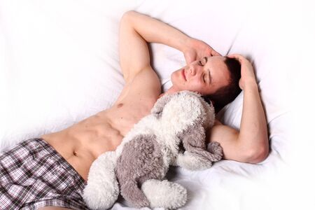 muscular man sleeping with toy