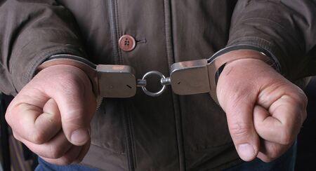 handcuffs in hand Stock Photo - 4695540