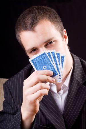 Businessman holding poker cards   Stock Photo - 5976948