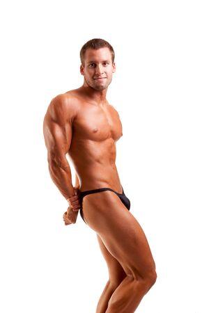 tricep: bodybuilder posing -flexing his tricep Stock Photo