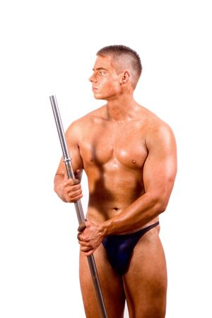 amateur bodybuilder posing over white background photo
