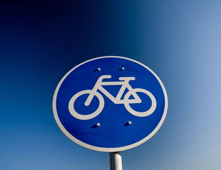 Bike lane traffic sign over blue sky Stock Photo - 6239492