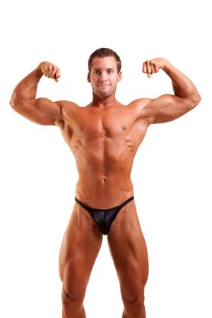 amateur bodybuilder posing over white background photo