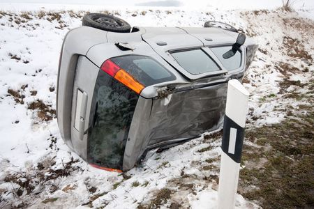 car flipped upside down in accident during winter storm
