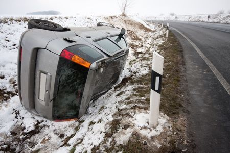 car flipped upside down in accident during winter storm photo