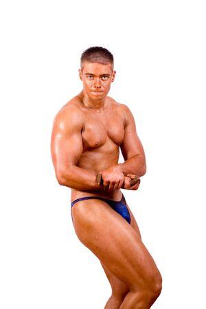young bodybuilder posing in studio photo