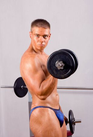 novice bodybuilder training his bicep photo