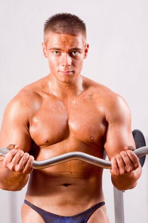 beginner: beginner Bodybuilder training in a gym