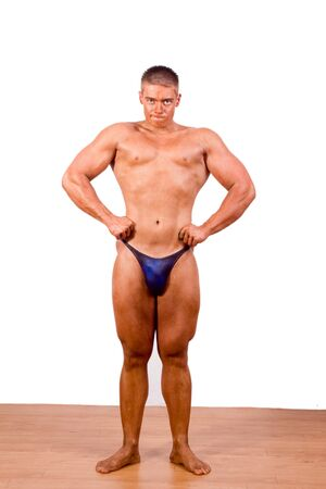 beginner: beginner Bodybuilder posing over white background Stock Photo