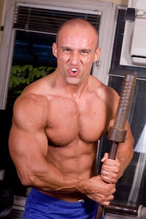Bodybuilder posing in the gym Stock Photo - 7215943