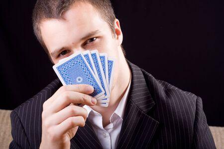 Businessman poker holding cards Stock Photo - 7279206