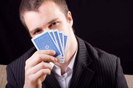 Businessman poker holding cards Stock Photo - 7279206