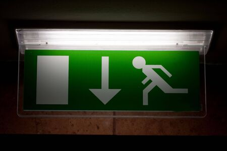 Emergency exit sign in a building  photo