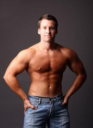 muscular model posing in studio photo