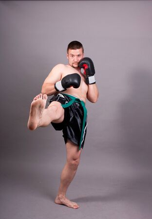 kick-boxer training before fight photo