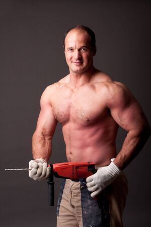 muscular construction worker with drill Stock Photo - 7766044