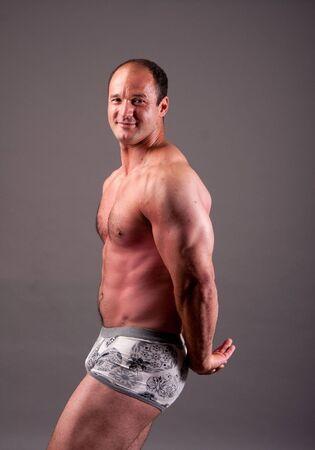mature bodybuilder posing in studio photo