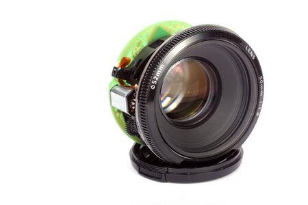 Broken lens on white background  photo