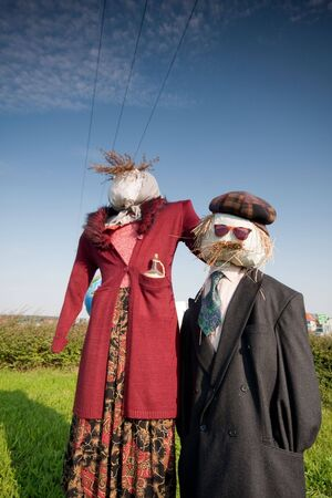 two scarecrows in the field photo