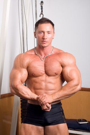 human body substance: Bodybuilder posing in the gym