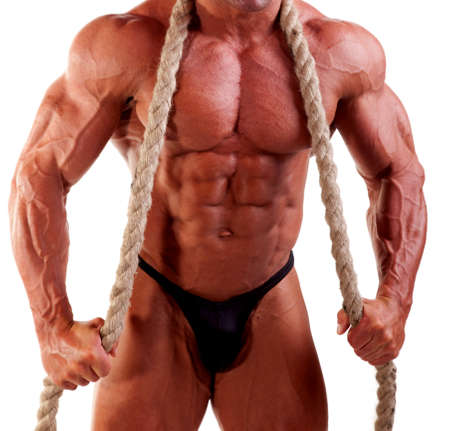 young bodybuilder posing with rope photo