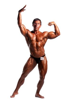 bodybuilder posing over white background Stock Photo - 8294907