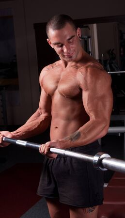Bodybuilder exercising in a gym photo